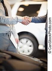 Two men shaking hand