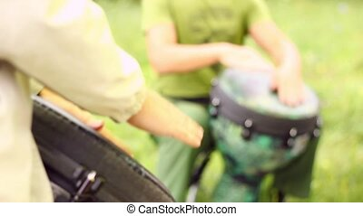 Two Men Skillfully Playing the Drums