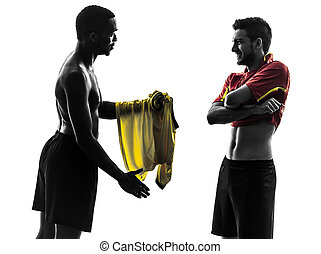two men soccer player exchanging jersey standing silhouette...