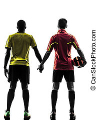 two men soccer player standing hand in hand silhouette - two...