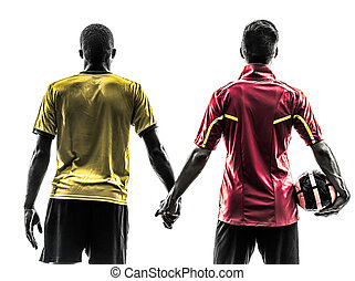 two men soccer player  standing holding hands silhouette