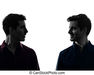 two men twin brother friends looking at each others...