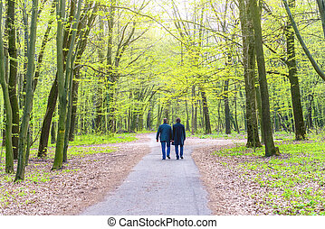 Two men walking in park