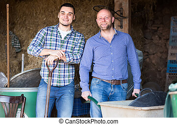 Two men working on a farm