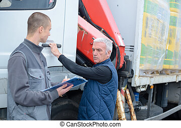 two men working on a truck