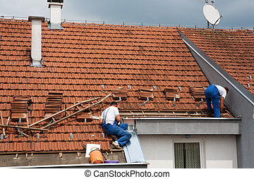 Men Roofing A House Many Men Working On Roofing A Large