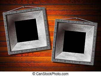Two Metal Frame on a Old Wood Wall