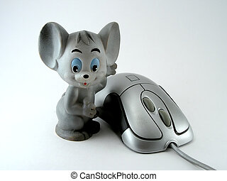 Two mice - Computer and toy mice cost on a white background...