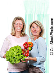 Two middle age woman with healthy food
