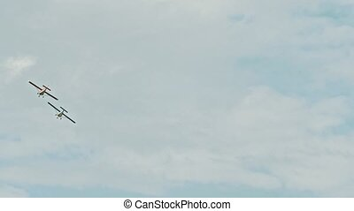 Two military aircrafts flying in the blue sky - blue and red airplanes
