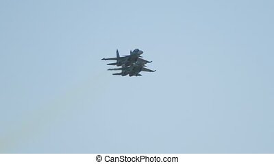 Two military fighter jets flying in the sky - fly nearby and...