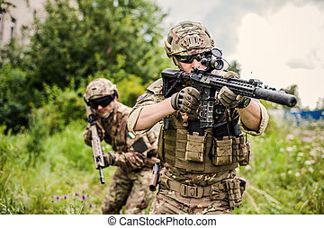 Two military man snipers with airsoft automatic rifle