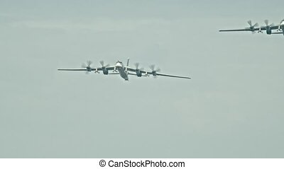 Two military transport aircrafts with four front vents...