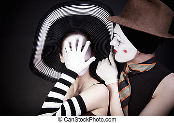 two mimes in hats
