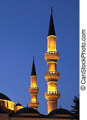 Two minarets at night. Ashkhabad. Turkmenistan.