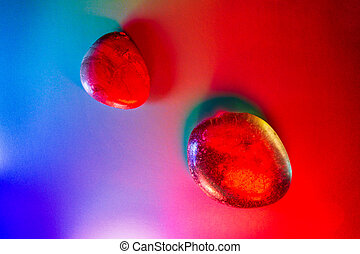 Two mineral gems colorfully illuminated showing abstract details.
