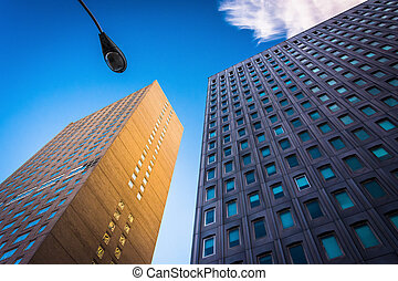 Two modern buildings and a streetlamp in Baltimore, Maryland.