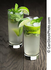 two mojito cocktails on old oak table, rustic style
