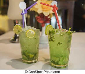 Two mojito cocktails on table in restaurant