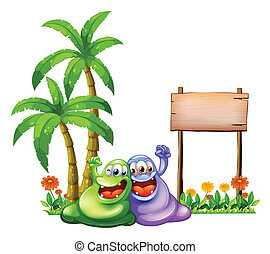 Two monsters having fun in front of the empty wooden signboard