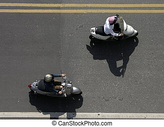 Two Mopeds Driving