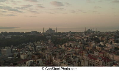 Two Mosques on a Hill at Hazy Sunrise in Istanbul, Aerial forward