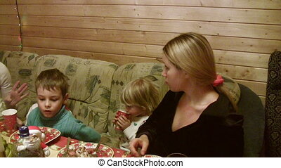 Two mothers with four children with children dine