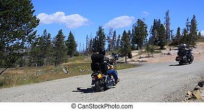 Two moto bikers on mountainous highway