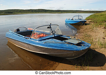 two motor boats on the shore
