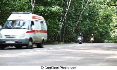 Two motorcyclists, first aid and truck on road