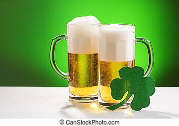 Two mugs of beer. Concept for St. Patrick's day.