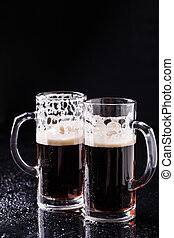 Two mugs on empty background