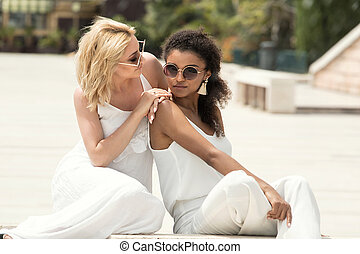 Two multiracial girlfriends having fun together.