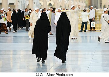 Two Muslim women walking - Islamic Holy Place