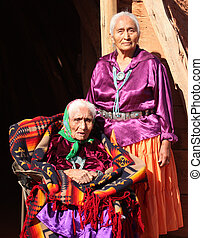 Two Navajo Women in Traditional Clothing Who Are Mother and Daughter Outdoors