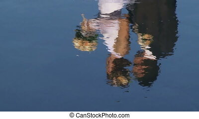 Two newlyweds are reflected