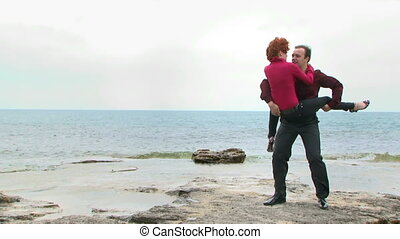 Two newlyweds have fun at sea