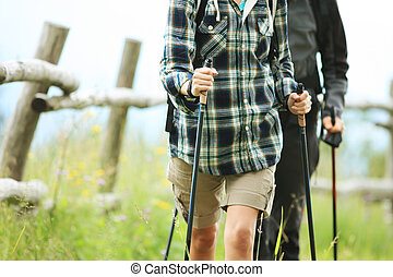 Two nordic walkers - Close up of two nordic walkers outdoors
