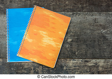 Two notebooks on wooden background