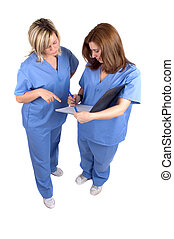 Two Nurses - Two Hospital Nurses Checking Patient Records