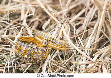 Two of Heart shape diamond ring on thatch texture