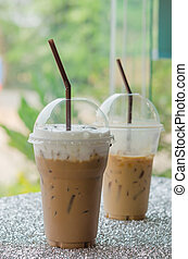 Iced coffee - two of Iced coffee with straw in plastic cup ...