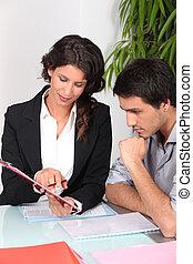 Two office workers brainstorming