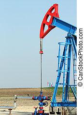 two oil pump jack on field