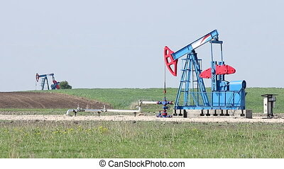 two oil pump jack on oilfield