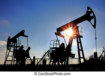 two oil pumps silhouette