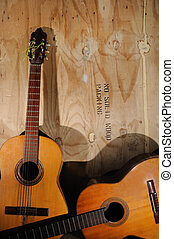 Old acoustic guitars - Two Old acoustic guitars against...