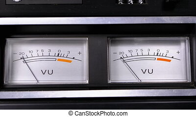Two Old Analog Dial vu Signal Indicators with Arrow. Meter of audio signal in decibels. Indicator Gauge Signal, Level Meter. Dial gauge modes Tape Recorder. Close-up. White scale of the device, black numbers.