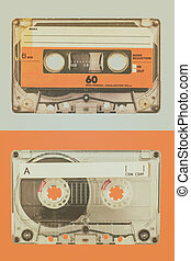 Two old audio compact cassettes on a blue with orange background