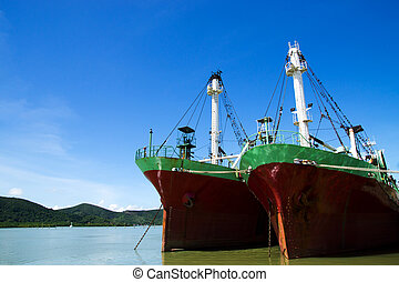 Two Old Cargo ship in harbor estuary.